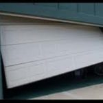 GARAGE DOOR WILL NOT GO UP OR DOWN OFF TRACK