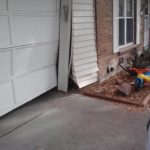 Damaged Garage Door Opening Due To Impact. Car Hit Garage